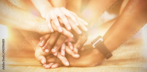 Business people putting their hands together on table
