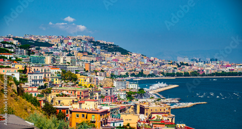 Spoed canvasdoek 2cm dik Napels Naples bay scenic view, Italy. Travel background picture with blue sea and cityscape in golden light of evening.