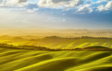 Tuscany misty panorama at sunset, rolling hills, fields, meadow. Italy