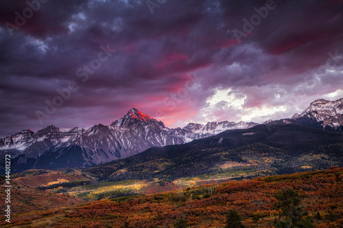 Fotobehang Aubergine Dramatic sunset over the Dallas Divide at Colorado's San Juan Mountains