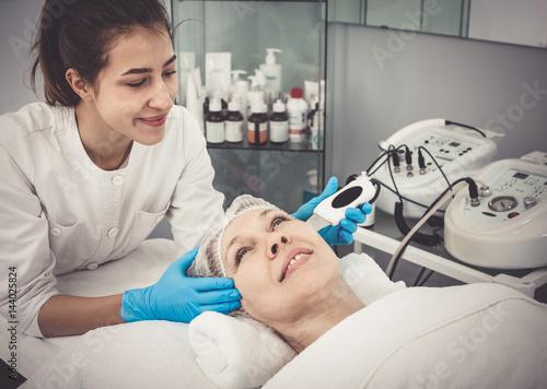 Mature woman having beauty procedures Poster