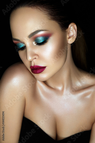 Beautiful woman portrait with glamour make up on black background.