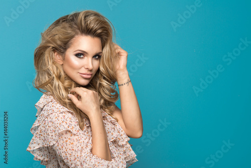 Plakat Portrait of wonderful young blonde woman with long hair looking at camera, smiling