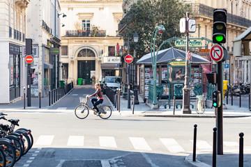 Woman riding a Velib bicycle in Paris