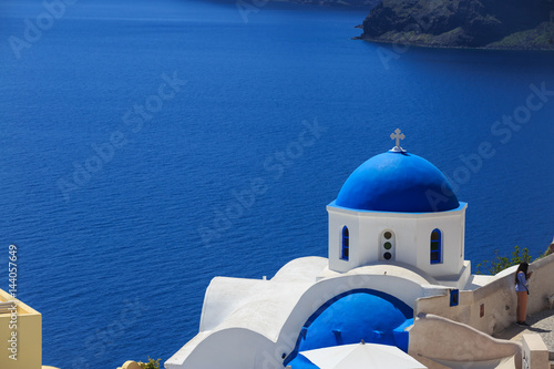 Santorini island in Greece - White church on blue background