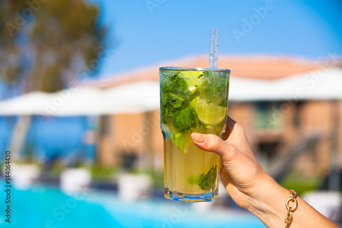 Lady holding glass of mojito in her hand. Poster
