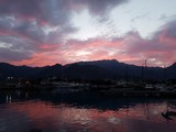 Yachts in the marina at sunrise against the backdrop of the mountains