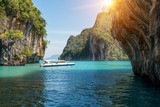 Beautiful landscape of rocks mountain and crystal clear sea with speed boat at Phuket, Thailand. Summer, Travel, Vacation, Holiday concept.