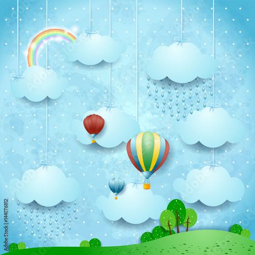 Surreal landscape with rain and hot air balloons