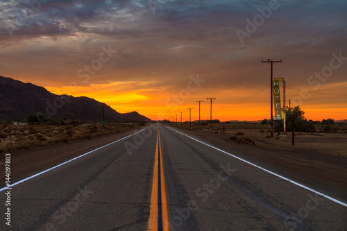 Fotobehang Route 66 Desert Road into the Sunset
