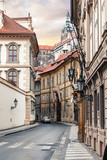 Morning in old city narrow street without people and cars in Prague.