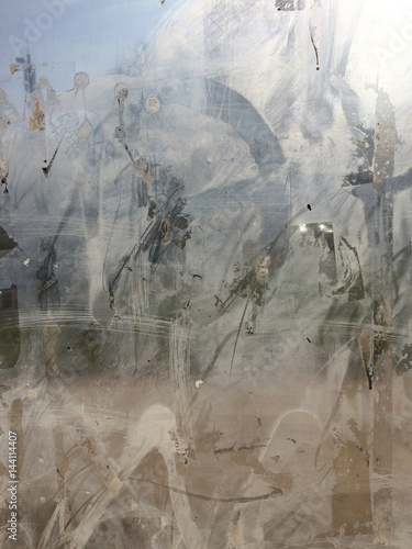 Dirty window glass. Urban abstract composition. Close up shot. - 144114407