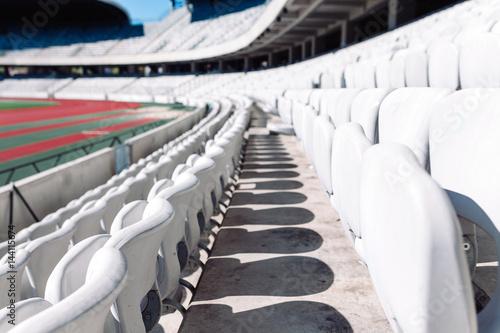 Stadium seats in daylight. Poster