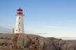 Lighthouse on rocks and blue sky