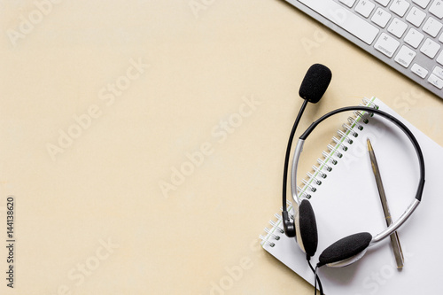Poster headset and keyboard on workdesk for call center concept top view mockup