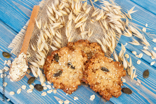 Poster Oatmeal cookies with ingredients and ears of oat, healthy dessert concept