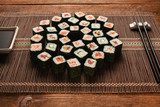 Delicious and tasty set of japanese sushi served on straw mat, closeup. Maki rolls, art food, luxury restaurant menu photo. National oriental seafood.