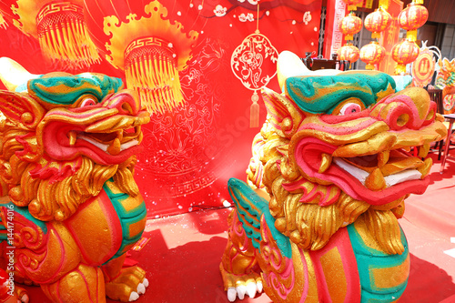 Close-up Detail face Chinese lion statue used during Chinese New Year celebratio Poster