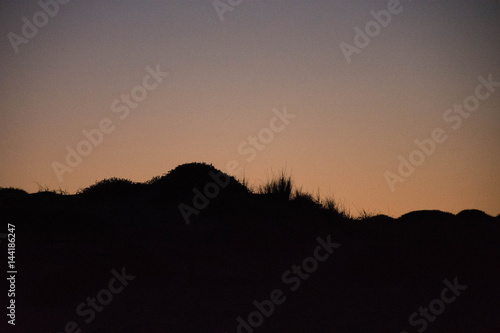 Sunset and the moon rising on the Mediterranean coast in southern Spain