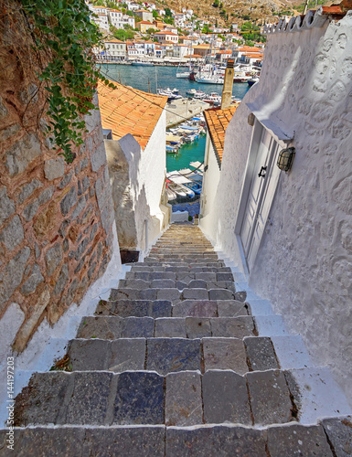 Greece, Hydra island, picturesque alley stairs to the port