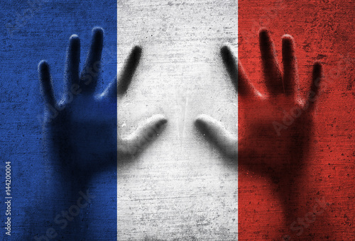 Plagát Aged textured France country flag with human hands.