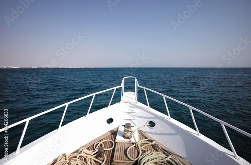 Poster White sailing boat with steer wheel