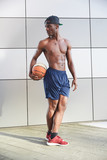 Portrait of afro american male basketball player with a ball