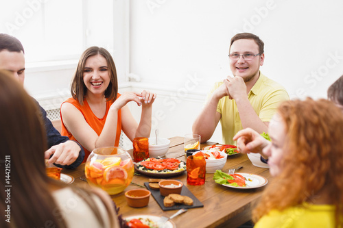 Group of happy people at festive table dinner party - 144215211