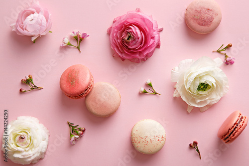 Flower and macarons pattern on a pink background. Various flower flat lay. Top view - 144224250