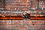 Old crumbling brick wall with decorative and reinforcement elements. Yaroslavl city, Russia.