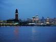 Hoboken Lackawanna clock tower, NJ transit, Path, light rail terminal and Midtown Manhattan in background at dusk