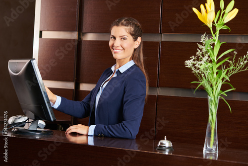 Friendly concierge at hotel reception