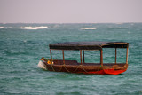 Scenic view of ocean and fisherman boat