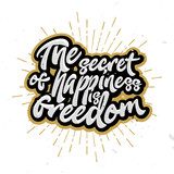 The secret of happiness is freedom - lettering, calligraphic letters.
