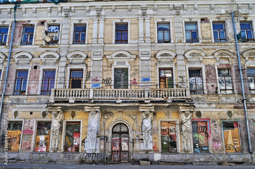 Ruined facade of a tenement house in the historic center of Moscow.