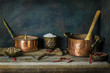Classic still life with old copper pots placed with fresh mixed pepper,salt and dry red chili on rustic wooden background