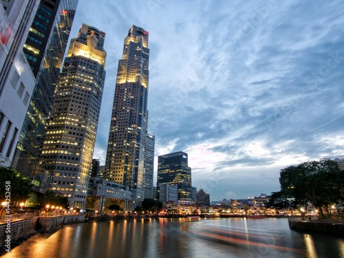 Singapore habor, skyscrapers and boat Poster