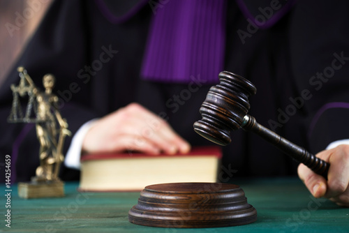 Law concept,Judge In A Courtroom Striking The Mallet