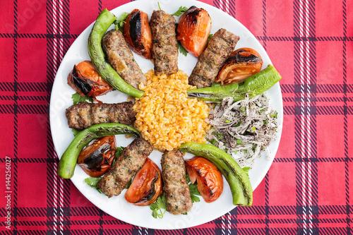 Turkish kebab served on plate - 144256027