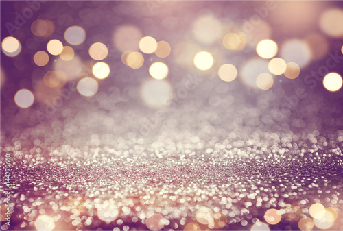 Pink or purple glitter and gold lights bokeh background. defocused