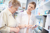 Professional pharmacist explaining prescription .