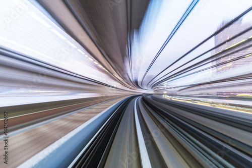 In de dag rail track and cityscape of tokyo from speed train