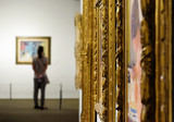 Girl looks at a painting at the Museum of Art - 144325026