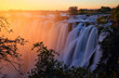 Постер, плакат: Victoria Falls at sunset Zambia