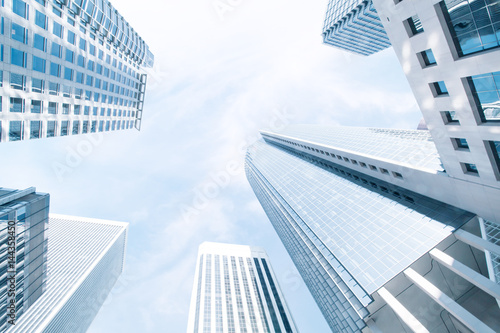 View of modern blue colored contemporary office city buildings   - 144358450