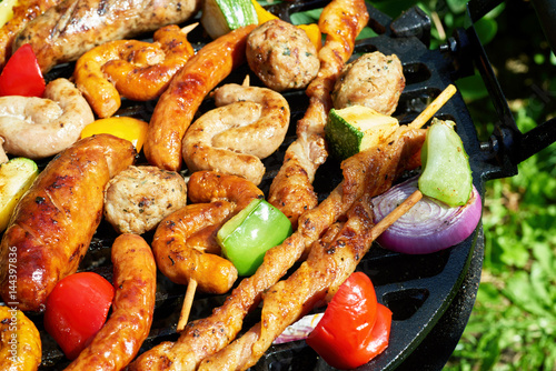 Assorted types of meat and vegetables on the grill Poster
