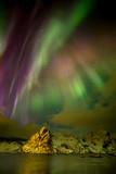 Aurora borealis (Polar lights) over the Lilandstinden mountain peak - Reinefjorden, Lofoten islands, Norway