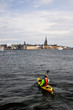 Cityscape of Stockholm with Canoe kayak flowing in the river.