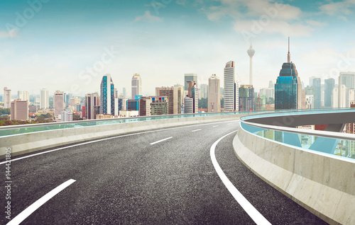 Highway overpass modern city skyline background Poster