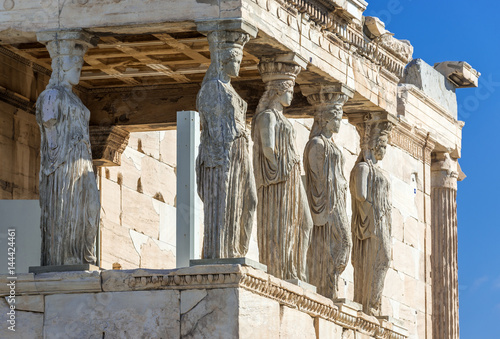 Close up on Caryatids sculptures of Erechtheion temple in Acropolis of Athens, Greece